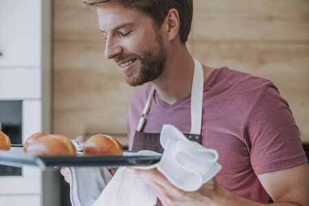 Man being satisfied with a result of his cooking