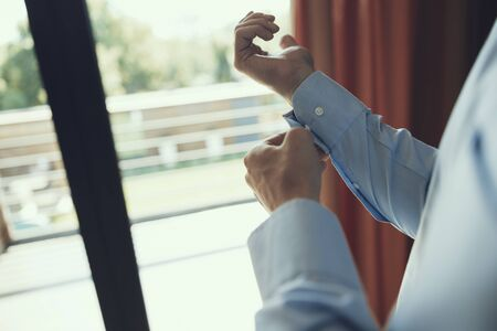 Man looking at the window and getting ready Stock Photo