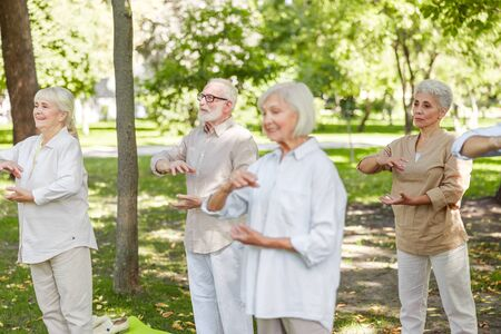 Senior people practicing traditional qigong in the park
