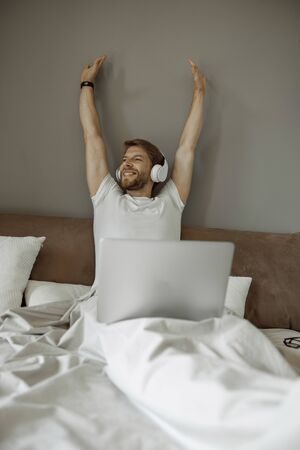Man waking up listening to his favorite music