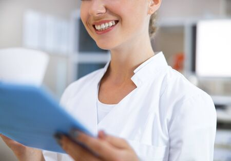 Cheerful therapist observing patient information stock photo Фото со стока