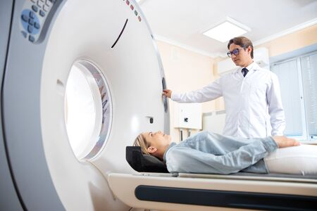 Young woman having CT scan in hospital