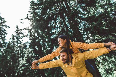 Traveler couple enjoying journey in rainy forest