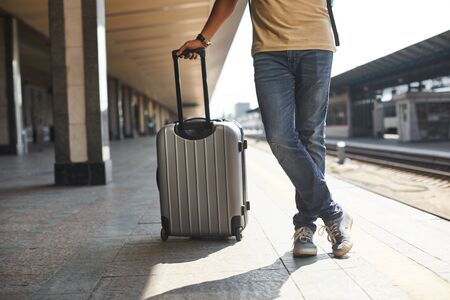 Low angle of a man carrying his luggage