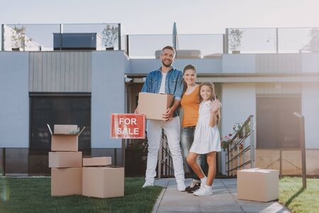 Joyful friendly family getting ready for a removal Stockfoto