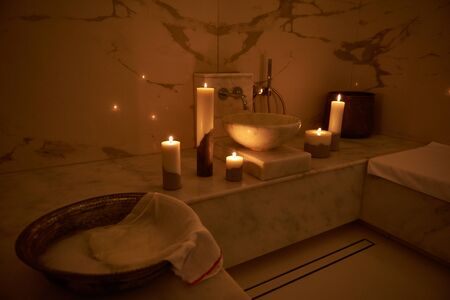 Romantic atmosphere of the Turkish bath with candles near the sink 스톡 콘텐츠