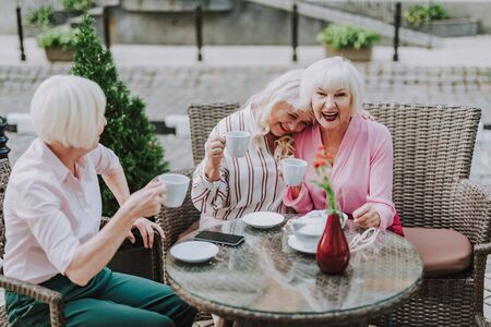 Laughing beautiful ladies are having fun together 스톡 콘텐츠