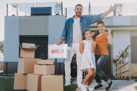 Overjoyed smiling family preparing for a removal