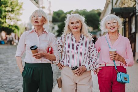 Happy stylish grandmothers are walking in the city