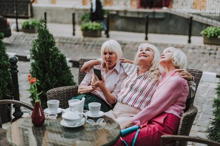 Pretty old women have rest in cafe