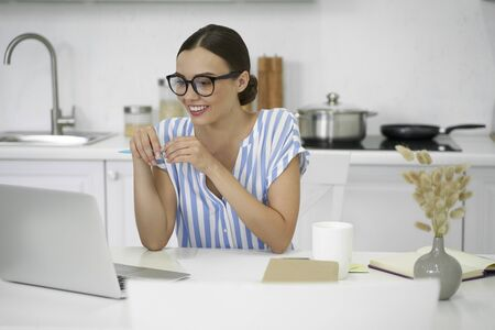 Self employed woman working at home and looking happy stock photo