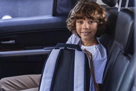 Happy kid is looking at camera in car Фото со стока