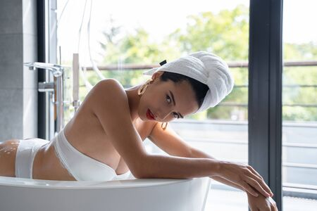 Relaxed good-looking woman lying in a bath