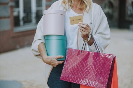 Female with bags and a credit card
