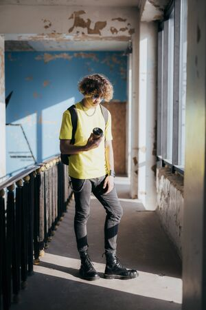 Young man with coffee in abandoned building stock photo Stock Photo