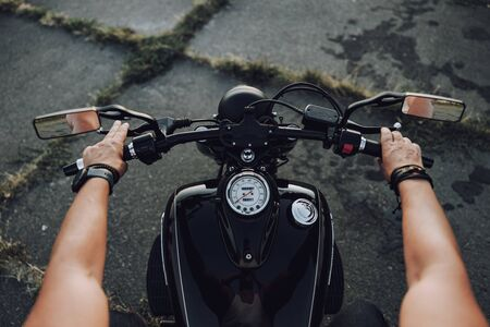 Top view of hands of a motorcyclist on steering wheel stock photo