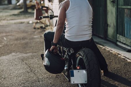Cropped photo of adult male having break outdoors stock photo 写真素材