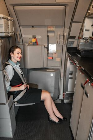 Happy Caucasian stewardess is ready for flight