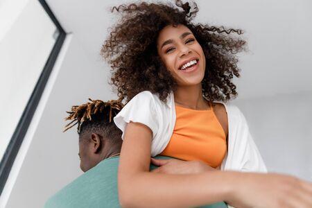 Cheerful lady having fun with her boyfriend