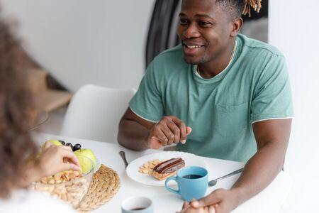 Joyful guy spending time with his girlfriend