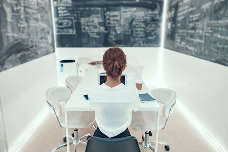Woman in the office back view stock photo