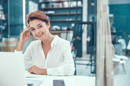 Happy smiling manager in the office stock photo
