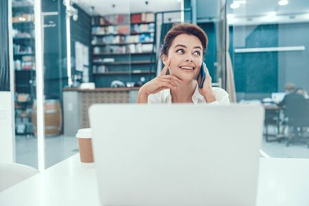 Dreamy mood of smiling office worker stock photo