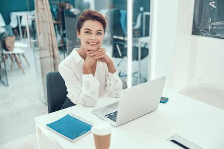 Positive woman in the office at the table stock photo Stock fotó