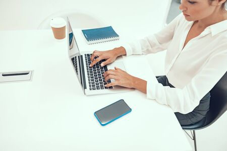 Concentrated office work with laptop stock photo