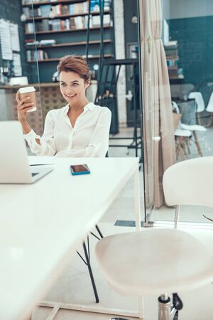 Office workplace and positive young woman stock photo