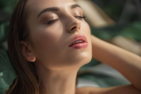 Beautiful young woman is relaxing with closed eyes 版權商用圖片