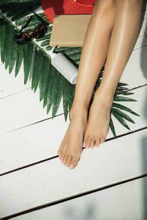 Top view of tanned legs of a girl