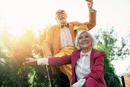 Joyful elderly spouses relaxing in park