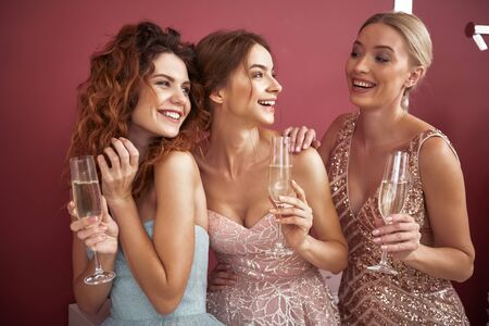 Waist up of cheerful ladies enjoying girls party
