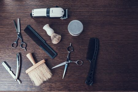 Set of different hair cutting instrument lying on desk Imagens