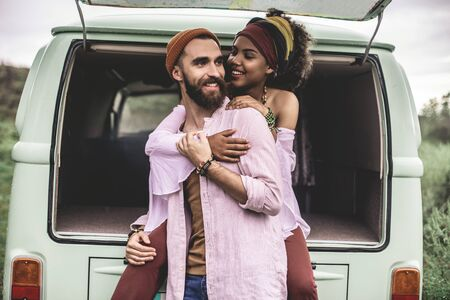 Hippie man and woman embracing each other