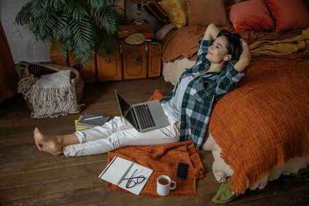 Happy woman is resting during work at home