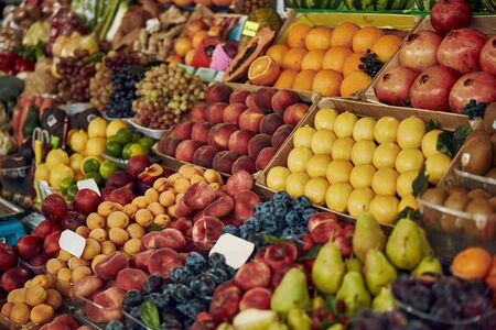 Fresh delicious fruits on the fruit display counter at the market Stock fotó
