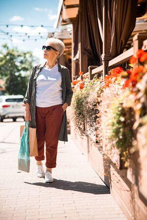 Stylish senior lady walking on the street 版權商用圖片