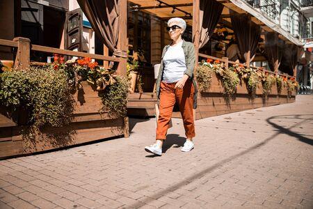 Stylish senior woman walking on the street