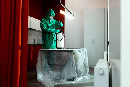Chemical specialist working with portable disinfectant tank stock photo