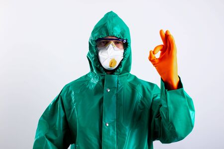 Disinfectant worker keeping everything under his control stock photo