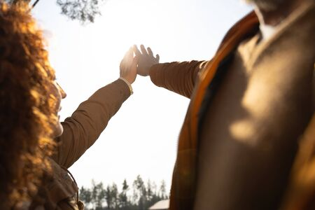 Close up of married couple touching sunlight with hands stock photo Imagens