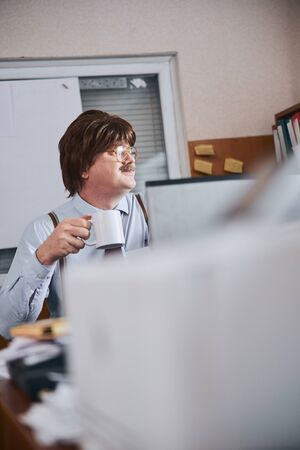 Mature officer or employee is busy on his workplace