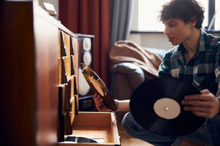 Handsome young man holding vintage vinyl records