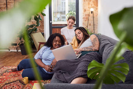 Relaxed young women enjoying a film at home