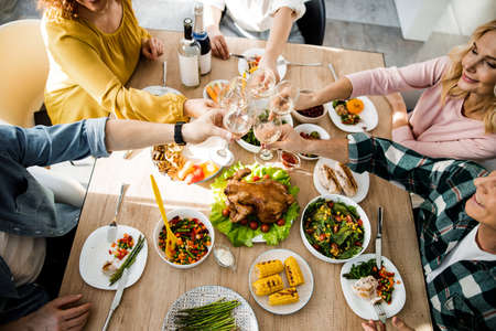 People celebrating thanksgiving together at home
