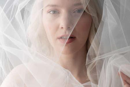 Attractive young woman wearing beautiful white veil Archivio Fotografico