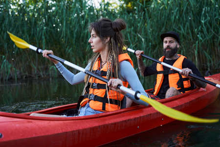 Young couple kayaking on river