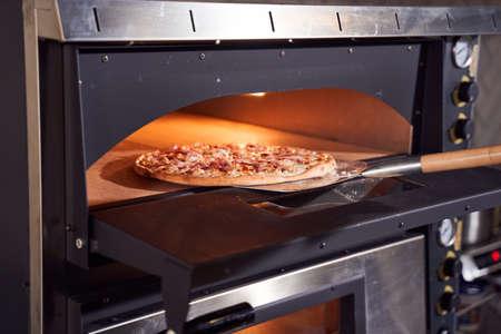 Baking tasty italian pizza concept